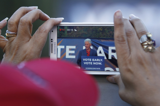 A fan shoots video of former President Bill Clinton during a Nevada Democratic Party campaign rally Tuesday, Oct. 28, 2014 at the Springs Preserve. (Sam Morris/Las Vegas Review-Journal)