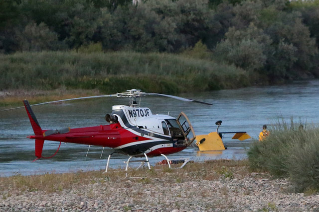 A yellow, two-seat helicopter crashed into the Colorado River Saturday evening, Oct. 4, 2014, just west of Grand Junction, Colorado. A witness confirmed two fatalities as a result of the crash. Du ...