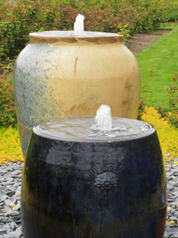 Thinkstock Two ornamental urn fountains grace a formal garden