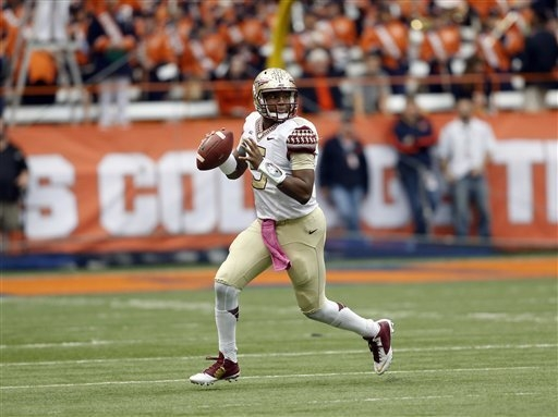 Florida State quarterback Jameis Winston (5) passes against Syracuse during the first half of an NCAA college football game on Saturday, Oct. 11, 2014, in Syracuse, N.Y. (AP Photo/Mike Groll)