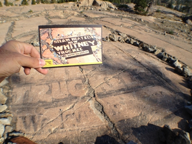 This photo taken on Sept. 24,, 2014, shows an early 1900s, advertisement painted in granite seeking to attract attention from early automobile traffic along the Lincoln Highway in Donner Pass, nea ...