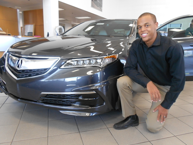 Courtesy photo Findlay Acura now has the 2015 TLX at its dealership at 315 Auto Show Dr. in the Valley Automall. Shown above with the vehicle is sales consultant Zachary Barnes.