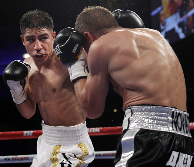 Jessie Vargas, left, hits Anton Novikov during their WBA Light Welterweight title fight at The Chelsea in the Cosmopolitan in Las Vegas on Aug. 2, 2014. (Jason Bean/Las Vegas Review-Journal)