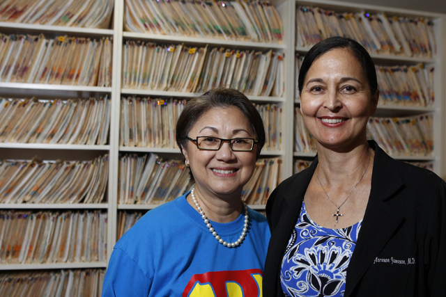 Aurora Wong, left, donor and collaborator to the future Ruffin Family Clinic, poses for a portrait with Dr. Florence Jameson at the Women's Wellness Center in Las Vegas Monday, Sept. 29, 2014. (Er ...