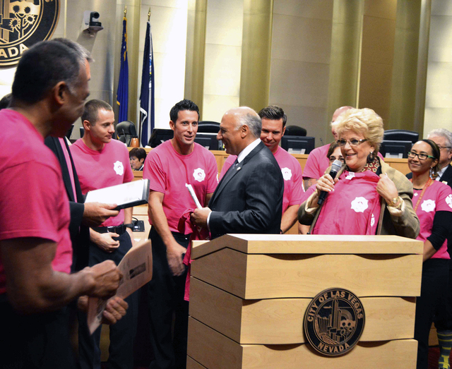 Members of the Las Vegas Fire & Rescue present Fighting Breast Cancer T-shirts to Las Vegas Mayor Carolyn Goodman and the City Council during its Oct. 15 meeting. Firefighters sold the shirts duri ...