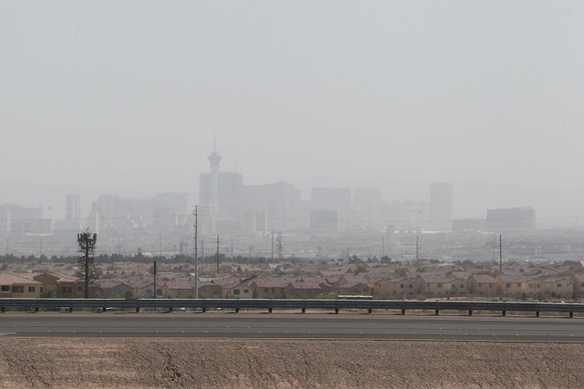 Downtown Las Vegas and the Strip are seen through dusty air from the intersection of Pecos Ave. and the Clark County 215 Beltway Monday afternoon, April 15, 2013. (Jerry Henkel/Las Vegas Review-Jo ...