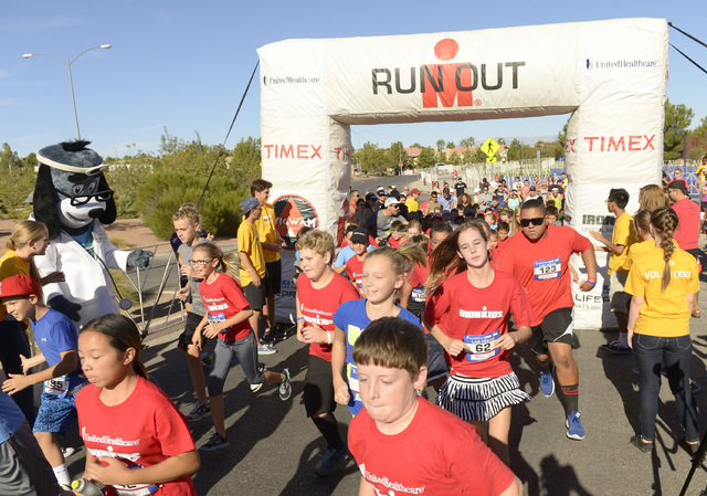 More than 200 youth and UnitedHealthcare's Dr. Health E. Hound take off for the finish line at the 2014 UnitedHealthcare IRONKIDS Las Vegas Fun Run at Henderson Pavilion, Saturday, Oct. 4, 2014. ...