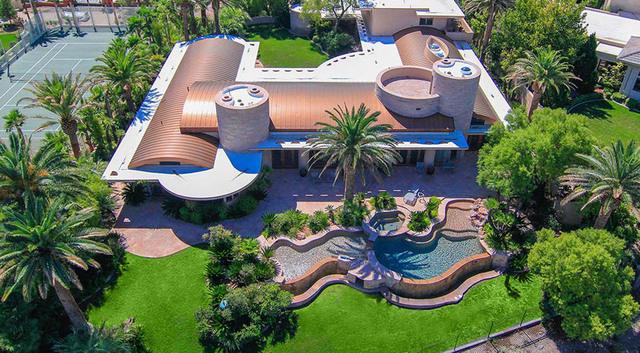 Photo courtesy  Fraser Almeida,  Luxury Homes Photography Realtor Kamran Zand's May $3.8 million sale of this high-profile 10,092-square-foot Frank Lloyd Wright-modern estate on Players Club Dri ...