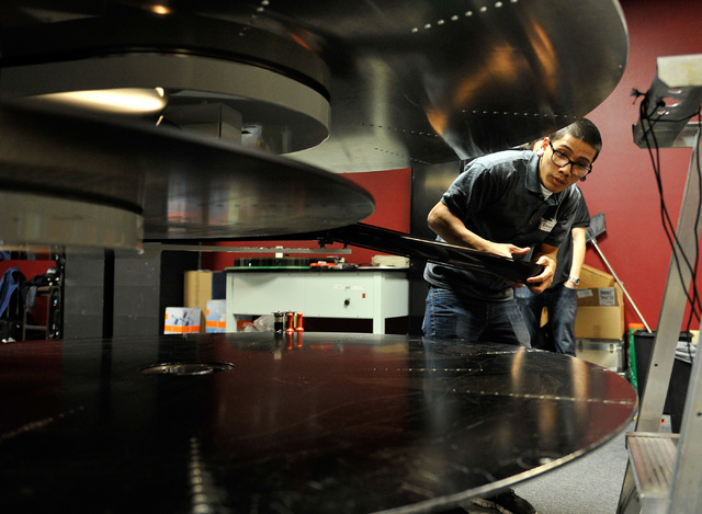 Projectionist Julian Attiya practices threading a 70mm film print at the Brenden Theatres inside the Palms hotel-casino Tuesday, Oct. 28, 2014. The Las Vegas movie theater will be showing the 70mm ...