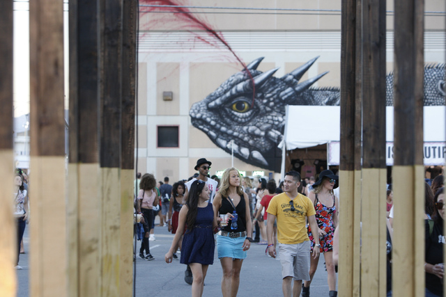 People walk during day two of the Life Is Beautiful music and art festival in downtown Las Vegas Saturday, Oct. 25, 2014. (Erik Verduzco/Las Vegas Review-Journal)