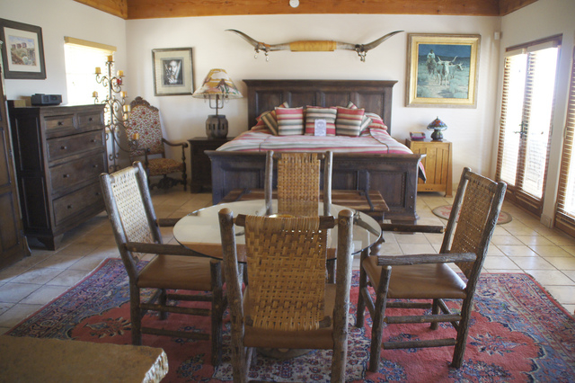 A bedroom that maintained a Southwest feel. (Art Nadler/Real Estate Millions)