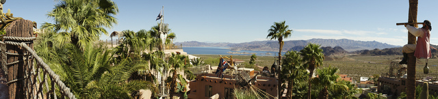 A Pirate on palm tree looks over Pirate's Cove and Lake Mead in distance. (Art Nadler/Real Estate Millions)