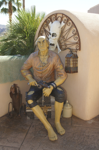 Owner Craig Tillotson got the idea of a pirate getaway while buying statues like this one at antique shops. (Art Nadler/Real Estate Millions)
