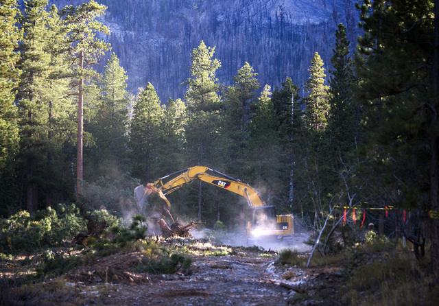 Construction on a  berm  at Rainbow Subdivision in Mount Charleston is seen Friday, Oct. 10, 2014. The U.S. Forest Service is building a 2200-2400-foot channel to divert waters from homes in the a ...
