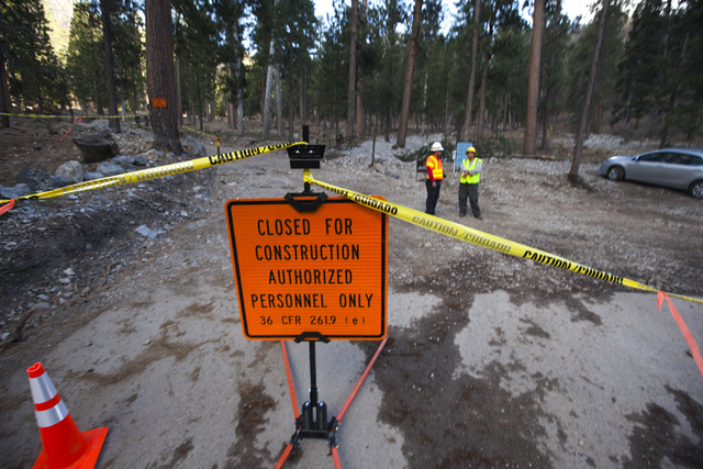 A construction site near where a berm is being built is seen Friday, Oct. 10, 2014 at Rainbow Subdivision in Mount Charleston. The U.S. Forest Service is building a 2200-2400-foot channel to diver ...
