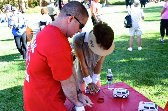 Las Vegas firefighters volunteered Oct. 11, 2014, to lead the warm-up for the Summerlin 5K Run & Fun Walk. After the run, they taught participants how to perform hands-only CPR and displayed infor ...