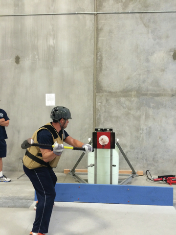 Las Vegas Fire & Rescue Capt. Eric Littmann demonstrates the types of physical tests required to apply as a firefighter. (Special to View)