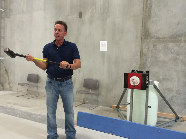 Greg Gammon, director of fire science programs at the College of Southern Nevada and former Las Vegas Fire & Rescue chief, demonstrates the types of physical tests required to apply as a firefight ...