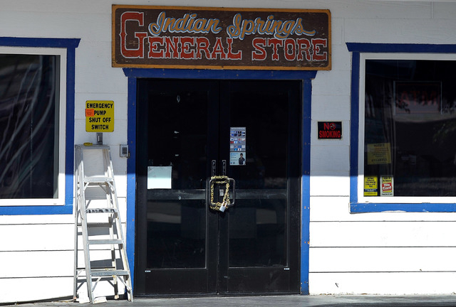 The Indian Springs General Store's doors are seen locked on Tuesday, Oct. 14, 2014. The roadside business, 45 miles north of downtown Las Vegas, was shuttered recently after  the U.S. Air Force to ...