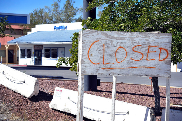 A spray painted sign alerts drivers that the Indian Springs Casino, Motor Hotel and General Store are now closed on Tuesday, Oct. 14, 2014. The roadside businesses, 45 miles north of downtown Las  ...