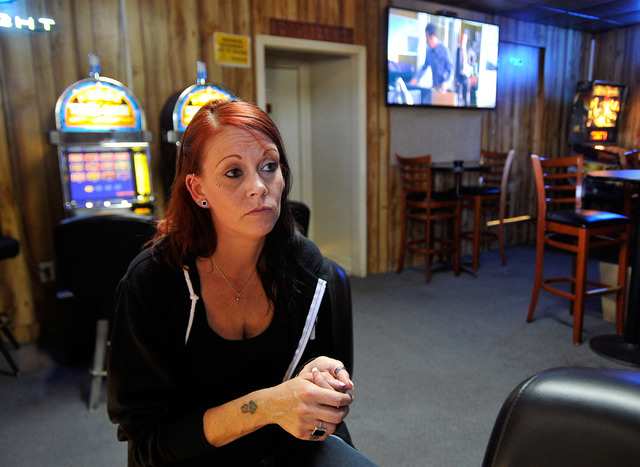 Melissa Trotter sits inside the Oasis in Indian Springs, Nev. on Tuesday, Oct. 14, 2014. Trotter is one of only a hand-full of employees that were kept on after the Indian Springs Casino, Motor Ho ...