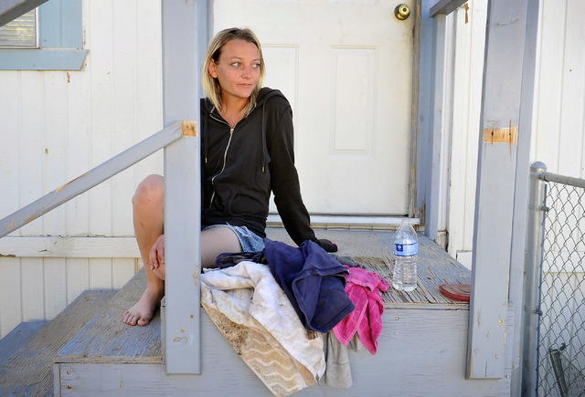 Jessica Colcord watches her son play with friends as she sits on her porch in Indian Springs, Nev. on Tuesday, Oct. 14, 2014. Colcord was laid off after the Indian Springs Casino closed on Oct. 1. ...
