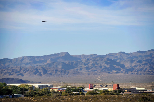 A MQ-1 Predator drone flies over Creech Air Force Base in Indian Springs, Nev. on Tuesday, Oct. 14, 2014. The U.S. Government recently completed the purchase of 16.9 acres boarding the base and cl ...