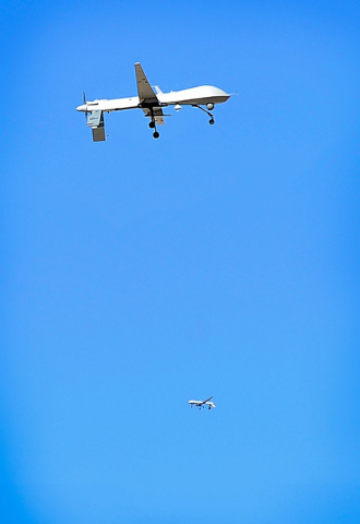 Two MQ-1 Predator drones fly over Creech Air Force Base in Indian Springs, Nev. on Tuesday, Oct. 14, 2014. (David Becker/Las Vegas Review-Journal)