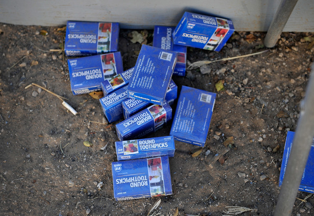 A dozen boxes of tooth picks are seen in the yard of Jessica Colcord in Indian Springs, Nev. on Tuesday, Oct. 14, 2014. Colcord, a recently laid-off worker at the now closed Indian Springs Casino  ...