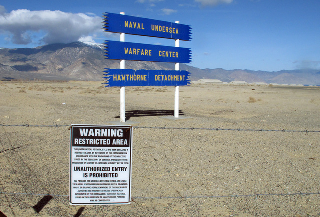 Signs are seen at the Hawthorne Army Depot on Tuesday, March 19, 2013, where seven Marines were killed and several others seriously injured in a training accident Monday night, about 150 miles sou ...