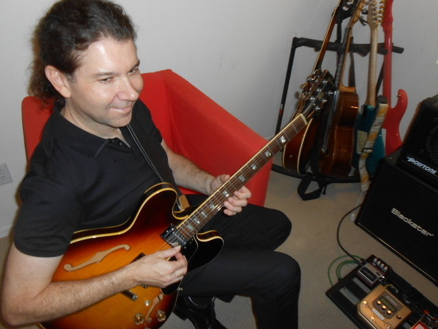 """Dirk Kleutgens, who performs as Dirk K, plays one of his guitars July 24, 2014, at his Summerlin home. His regular job is as the sound engineer for """"Zumanity,"""" but he is driven to release CDs unde ..."""
