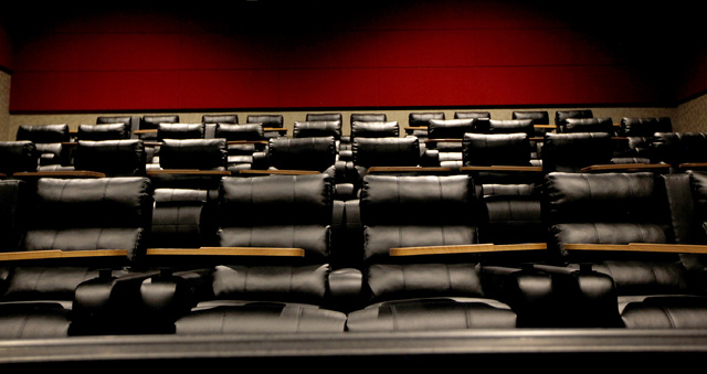 Chairs that fully recline with a small table for eating food and drinking beverages are featured in the Regal Downtown Summerlin 5 cinema in Las Vegas on Wednesday, Oct. 1, 2014. The cinema will o ...