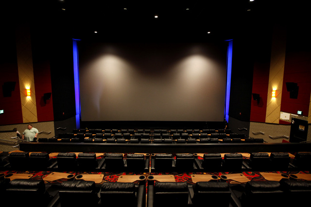 Chairs that fully recline with a small table for eating food and drinking beverages are featured in the Regal Downtown Summerlin 5 cinema in Las Vegas on Wednesday, October 1, 2014. The cinema wil ...