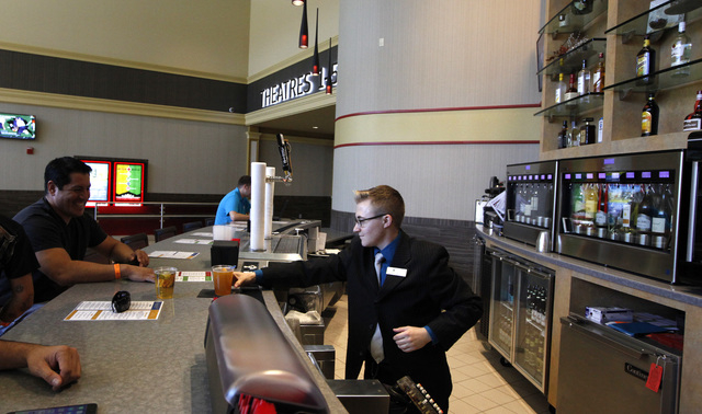 Ande Heitz, center, serves a beer to patrons at the Regal 5 Downtown Summerlin cinema on Monday, Oct. 6, 2014, in Las Vegas. (Justin Yurkanin/Las Vegas Review-Journal)