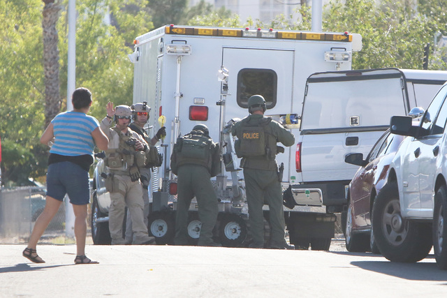 Las Vegas police and SWAT are working a barricade situation Thursday, Oct. 16, 2014, near Downtown Las Vegas. Officers responded to a home at 805 N. First St. just after 1 p.m. Thursday where a ma ...