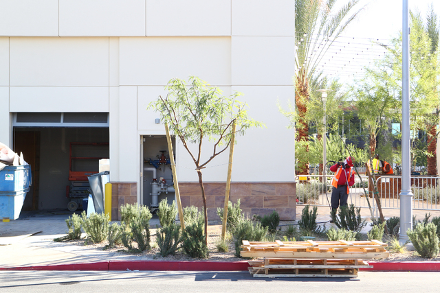 A construction worker cleans a sidewalk as work goes on the day before the official opening of Downtown Summerlin in Las Vegas on Wednesday, Oct. 8, 2014. (Chase Stevens/Las Vegas Review-Journal)