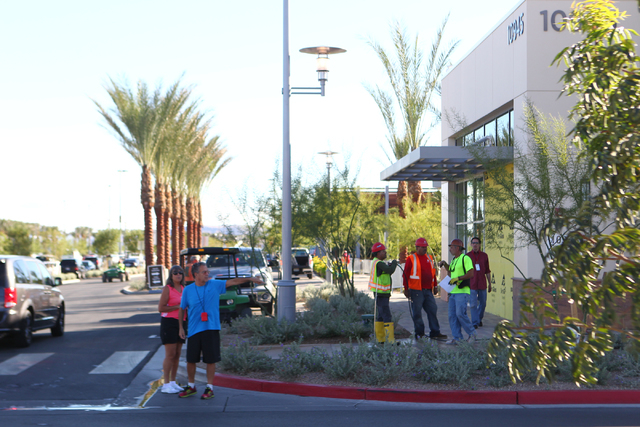 Construction workers and pedestrians are seen as work goes on the day before the official opening of Downtown Summerlin in Las Vegas on Wednesday, Oct. 8, 2014. (Chase Stevens/Las Vegas Review-Jou ...