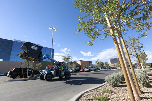 A construction vehicle goes by as work goes on the day before the official opening of Downtown Summerlin in Las Vegas on Wednesday, Oct. 8, 2014. (Chase Stevens/Las Vegas Review-Journal)