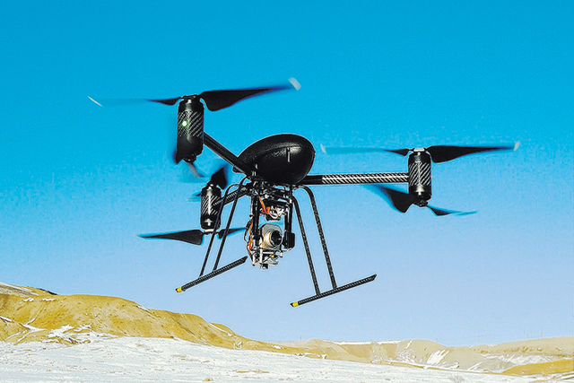 A small Draganflyer X6 drone is shown during a test flight in Mesa County, Colorado, Jan. 8, 2009, with a Forward Looking Infer Red payload. The FBI has been using drones to support its law enforc ...