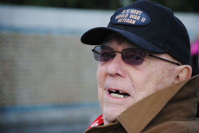 Robert Abbott, 91, of Las Vegas served in the U.S. Navy during WWII. As a member of the catapult crew on the USS Manila Bay, Abbott was blown off the deck of the escort cruiser when a Japanese kam ...