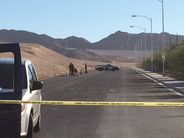 Las Vegas Police investigate an accident scene Friday, Oct. 31, 2014, near Sahara Avenue and Hollywood Boulevard. Two men sitting on the trunk of a car driven by a 19-year-old female were seriousl ...