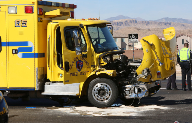 The intersection of Blue Diamond Road and Durango Drive is partially blocked after a Clark County fire truck and an SUV collided on Friday, Oct. 31, 2014. Four people were transported to a Las Veg ...