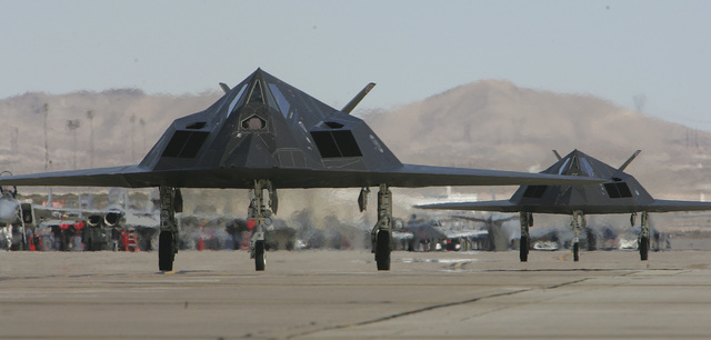 Two F-117A Nighthawk stealth fighter jets taxi back to their parking area after participating in Red Flag exercises at Nellis Air Force Base Monday Feb. 13, 2006. The entire fleet of revolutionary ...