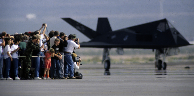 An estimate crowd of 100,000 attended the unveiling of the F-117A Stealth fighter at Nellis Air Force base on April 21, 1990, near Las Vegas, Nevada. (Jeff Scheid/Las Vegas Review-Journal)