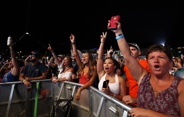 Fans cheer as Tyler Farr performs at the Route 91 Harvest country music festival at the MGM Resorts Village in Las Vegas on Sunday, October 5, 2014. (Justin Yurkanin/Las Vegas Review-Journal)