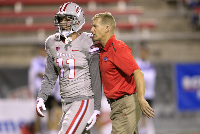 UNLV head coach Bobby Hauck talks with defensive back Troy Hawthorne before their game against Fresno State Friday, Oct. 10, 2014 at Sam Boyd Stadium. (Sam Morris/Las Vegas Review-Journal)