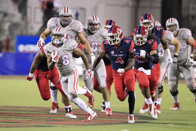 UNLV running back Keith Whitely gets away from the Fresno State defense during their game Friday, Oct. 10, 2014 at Sam Boyd Stadium. (Sam Morris/Las Vegas Review-Journal)