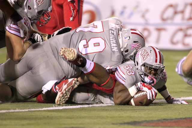 UNLV running back Shaquille Murray-Lawrence gets over the goal line against Fresno State during their game Friday, Oct. 10, 2014 at Sam Boyd Stadium. (Sam Morris/Las Vegas Review-Journal)