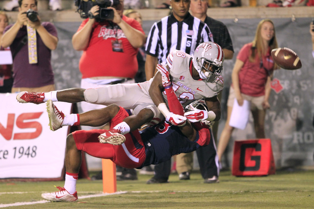 UNLV wide receiver Marcus Sullivan is draws pass interference on Fresno State safety Charles Washington during their game Friday, Oct. 10, 2014 at Sam Boyd Stadium. (Sam Morris/Las Vegas Review-Jo ...