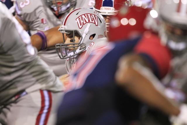 UNLV quarterback Blake Decker scrambles through the Fresno State defense during their game Friday, Oct. 10, 2014 at Sam Boyd Stadium. (Sam Morris/Las Vegas Review-Journal)
